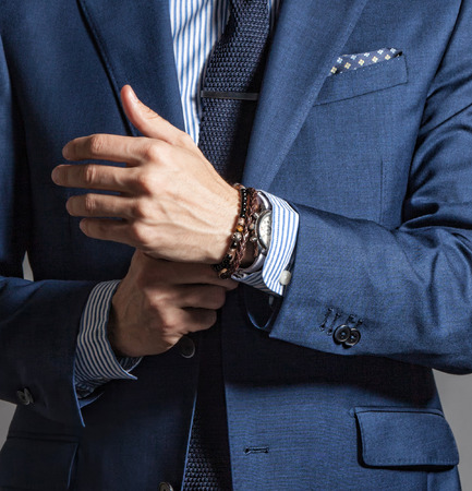 Suave modern man in casual style with bracelets on hand Stockfoto