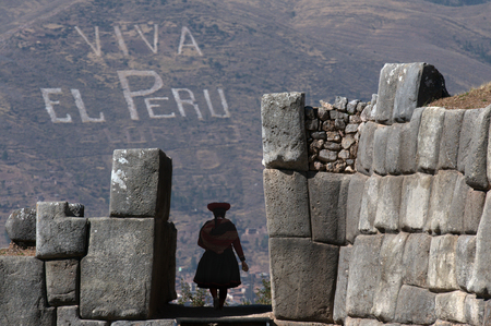 Typical woman with stones in Cuzco Peru