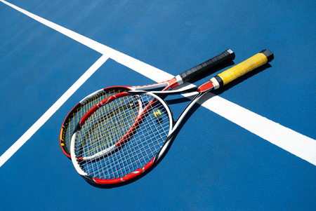 Couple of tennis rackets on the court Stock Photo