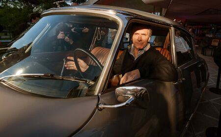 Buenos Aires, Argentina - November 13 2010: The next President of Argentina Mauricio Macri when he was head of the executive branch of Buenos Aires government, trying an old car next to the city planetarium.