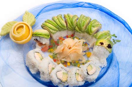 Sushi Caterpillar Roll en een oranje Rose Stockfoto