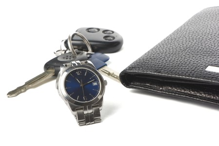 watch, wallet and keys for car on the white background with shadow. photo