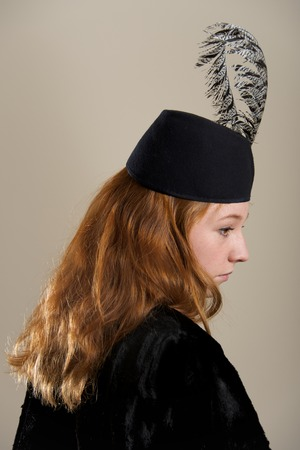 black feathered: Redhead in black feathered hat in profile