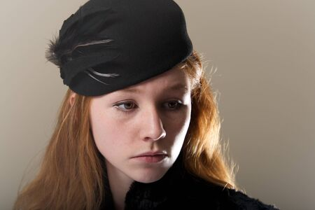 black feathered: Close-up of redhead in black feathered hat