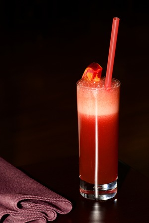sherbet: Tall glass of red sherbet with napkin