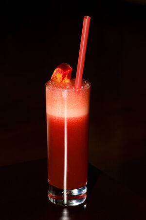 sherbet: Tall glass of red sherbet with straw Stock Photo