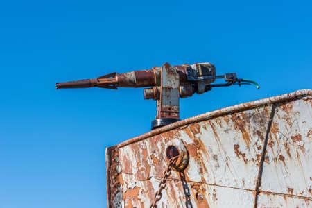 harpoon: Close-up of rusty harpoon gun in bows