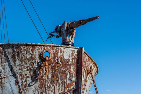 whaling: Close-up of harpoon gun on rusty whaler