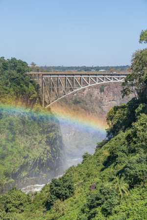 beneath: Close-up of rainbow beneath Victoria Falls Bridge Stock Photo