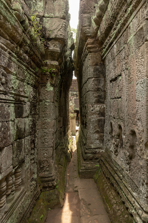 Narrow passage between leaning walls of temple