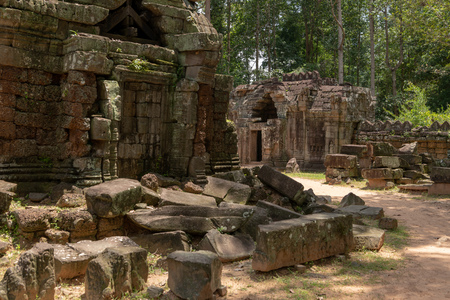 Fallen stone blocks litter grounds of temple