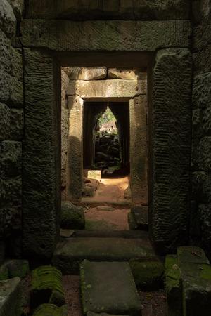 Stone corridor of temple leading towards trees Stock fotó