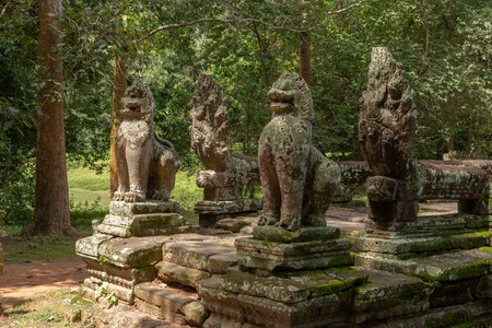 Stone lions and snakes guard Banteay Kdei