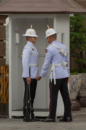 Grand Palace officer inspects jacket of soldier