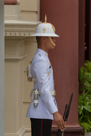 Close-up of Grand Palace guard holding rifle Editorial