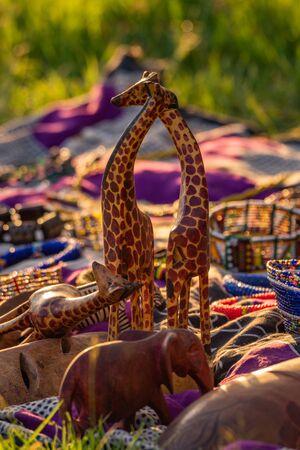 Two model giraffes for sale at market