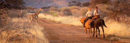 Panorama of one horsewoman pointing to another