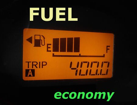 Fuel economy: fuel gauge and odometer showing a minimum fuel consumption Stock fotó - 97995959