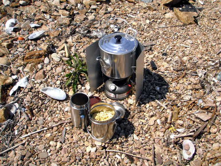 Gas stove (primus stove) boiling kettle outdoors Stock Photo - 98310173