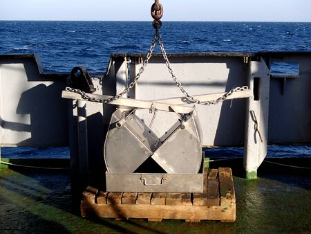 The benthic grab on the deck of the vessel