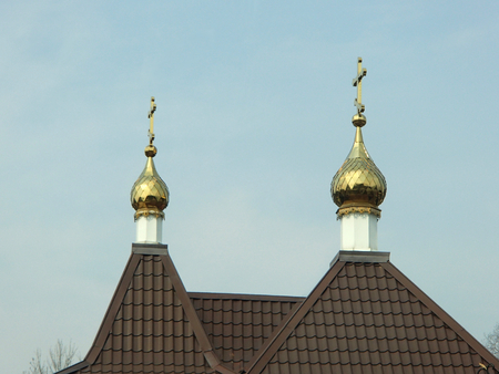 Church roof with golden cupola and crosses on the sky background
