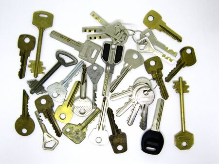 Many different old used keys on white background