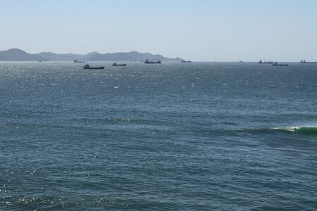 Cargo ships standing in harbor at anchor. 写真素材