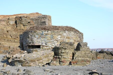 Old navy fortification made of coastal stones in the rocks. The coast of the Sea of Japan, Russia, Vladivostok, Tobizina Cape.