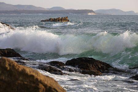 Ocean waves hitting the rocky sea beach. Reklamní fotografie - 136857791