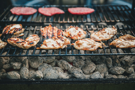 Barbecued chicken and ham on the grill
