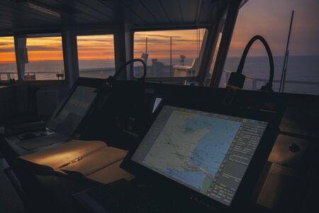 wheelhouse in modern ship with ECDIS and Bridge Log book Stock Photo