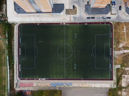 Aerial photography of a football field in the Park, city. people train on the field Banco de Imagens - 131974151