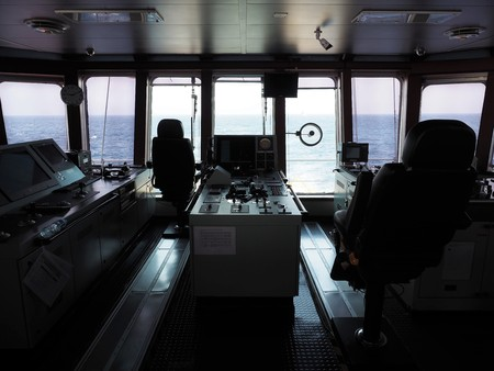Dynamic positioning control desk on supply vessels bridge.