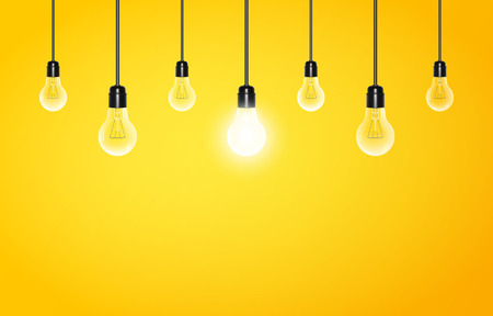 Hanging light bulbs with glowing one on a yellow background, copy space. Vector illustration for your design Vectores