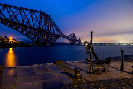 A blue night sky over the Forth bridge in Scotland Stok Fotoğraf