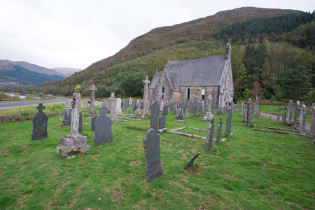 A peaceful graveyard by a Scottish loch