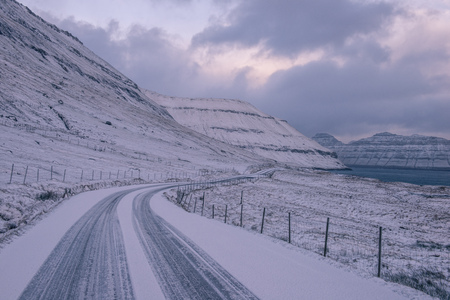 a snow covered road in the faroe islands Stok Fotoğraf