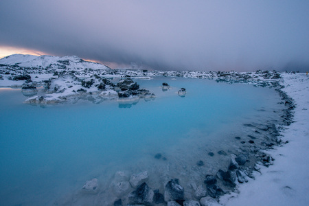 A geothermal pool glows blue in Iceland Stock Photo