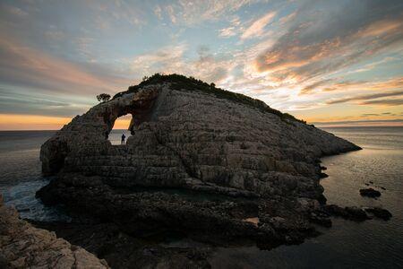 Sunset over the rocks at korakonisi zakynthos Stock Photo