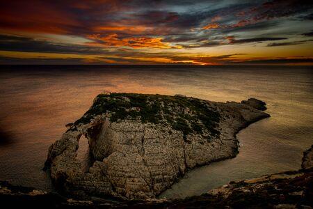 sunset over the rocks at korakonisi zakynthos