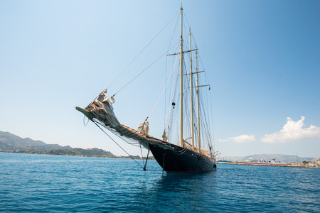 A yacht outside of the harbour of zakynthos Stock Photo