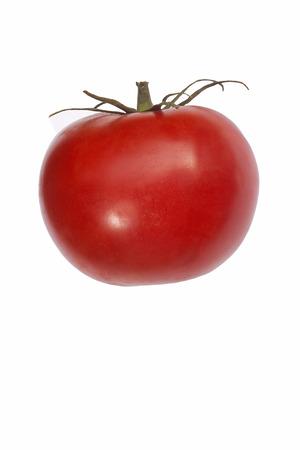 Beefsteak tomato (Solanum lycopersicum). Image of single tomato isolated on white background Stock Photo