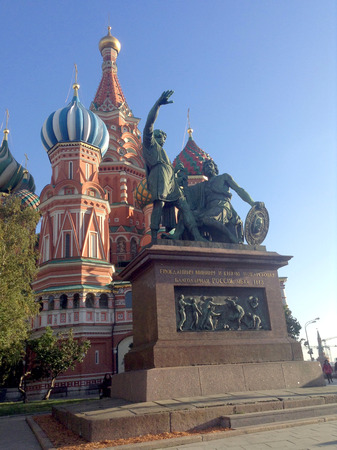 st  basil: MOSCOW, RUSSIA  Monument to Minin and Pozharsky and St. Basil Cathedral on Red square in Moscow