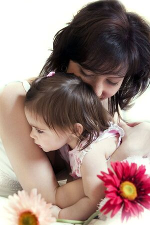 happy young mother hugs her little daughter. Isolated on white background Stock Photo - 637818