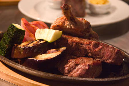 broil: appetizing pieces of roasted meat and zucchini on the plate