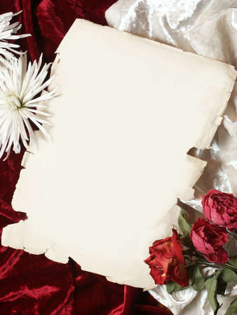 desiccated: piece of old paper, red and white velvet wrinkles background, desiccated red roses and white chrysanthemum