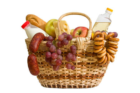 basket with apples, grapes, milk, oil, cheese and bread. Isolated on white background, with clipping-path photo
