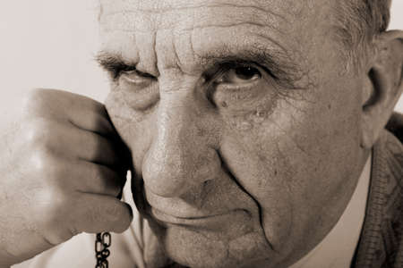 strictly: portrait of serious old man looking strictly into the camera. Sepia Stock Photo