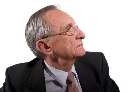 crinkles: Portrait of concentrated serious old man in glasses, isolated on white Stock Photo
