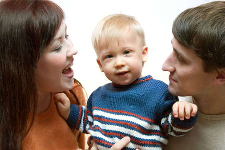 thier: Happy family - father, mother and thier cute little son